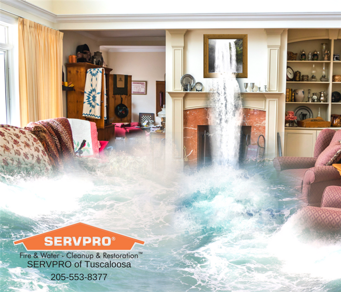 living room in a home with flooding water with a SERVPRO logo