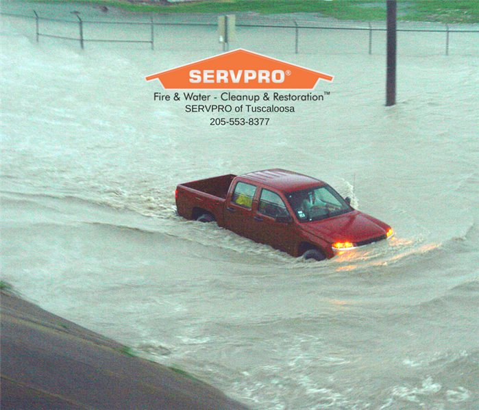 A truck in Northport, AL flooded in the street by an overload of rain water.